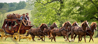 two-males_outdoors_on-stagecoach_413x185